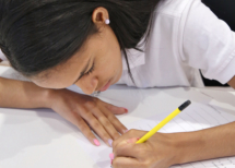 female kid writing