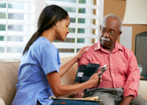 caregiver checking on senior man